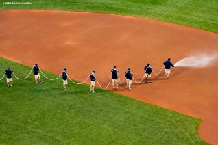 BOSTON, MA - SEPTEMBER 1: Members of the grounds crew prepare the field before before a game between the Boston Red Sox and the Atlanta Braves on September 1, 2020 at Fenway Park in Boston, Massachusetts. The 2020 season had been postponed since March due to the COVID-19 pandemic. (Photo by Billie Weiss/Boston Red Sox/Getty Images) *** Local Caption ***