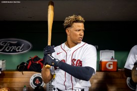 BOSTON, MA - SEPTEMBER 1: Yairo Munoz #60 of the Boston Red Sox warms up in the dugout before his Boston Red Sox debut game against the Atlanta Braves on September 1, 2020 at Fenway Park in Boston, Massachusetts. The 2020 season had been postponed since March due to the COVID-19 pandemic. (Photo by Billie Weiss/Boston Red Sox/Getty Images) *** Local Caption *** Yairo Munoz