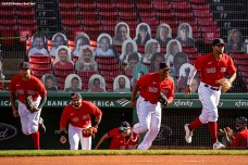 BOSTON, MA - SEPTEMBER 4: Yairo Munoz #60, Jose Peraza #3, Rafael Devers #11 and Xander Bogaerts #2 of the Boston Red Sox run onto the field before a game against the Toronto Blue Jays on September 4, 2020 at Fenway Park in Boston, Massachusetts. The 2020 season had been postponed since March due to the COVID-19 pandemic. (Photo by Billie Weiss/Boston Red Sox/Getty Images) *** Local Caption *** Yairo Munoz; Jose Peraza; Rafael Devers; Xander Bogaerts