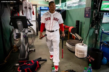 BOSTON, MA - SEPTEMBER 18: Rafael Devers #11 of the Boston Red Sox looks on in the batting cage before a game against the New York Yankees on September 18, 2020 at Fenway Park in Boston, Massachusetts. The 2020 season had been postponed since March due to the COVID-19 pandemic. (Photo by Billie Weiss/Boston Red Sox/Getty Images) *** Local Caption *** Rafael Devers