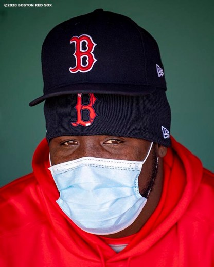BOSTON, MA - SEPTEMBER 20: Domingo Tapia #66 of the Boston Red Sox wears a mask as he looks on before a game against the New York Yankees on September 20, 2020 at Fenway Park in Boston, Massachusetts. The 2020 season had been postponed since March due to the COVID-19 pandemic. (Photo by Billie Weiss/Boston Red Sox/Getty Images) *** Local Caption *** Domingo Tapia