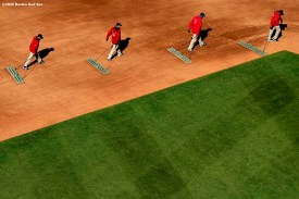 BOSTON, MA - SEPTEMBER 20: Members of the Grounds Crew work during a game between the Boston Red Sox and the New York Yankees on September 20, 2020 at Fenway Park in Boston, Massachusetts. The 2020 season had been postponed since March due to the COVID-19 pandemic. (Photo by Billie Weiss/Boston Red Sox/Getty Images) *** Local Caption ***