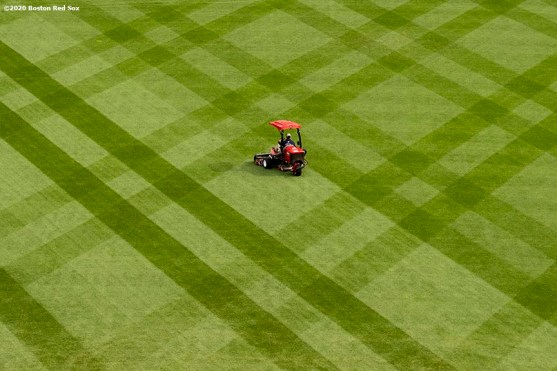 BOSTON, MA - SEPTEMBER 22: A member of the grounds crew mows the grass before a game between the Boston Red Sox and the Baltimore Orioles on September 22, 2020 at Fenway Park in Boston, Massachusetts. The 2020 season had been postponed since March due to the COVID-19 pandemic. (Photo by Billie Weiss/Boston Red Sox/Getty Images) *** Local Caption ***