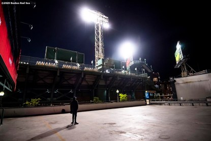 BOSTON, MA - SEPTEMBER 23: A man watches from the Lansdowne Garage during a game between the Boston Red Sox and the Baltimore Orioles on September 23, 2020 at Fenway Park in Boston, Massachusetts. The 2020 season had been postponed since March due to the COVID-19 pandemic. (Photo by Billie Weiss/Boston Red Sox/Getty Images) *** Local Caption ***