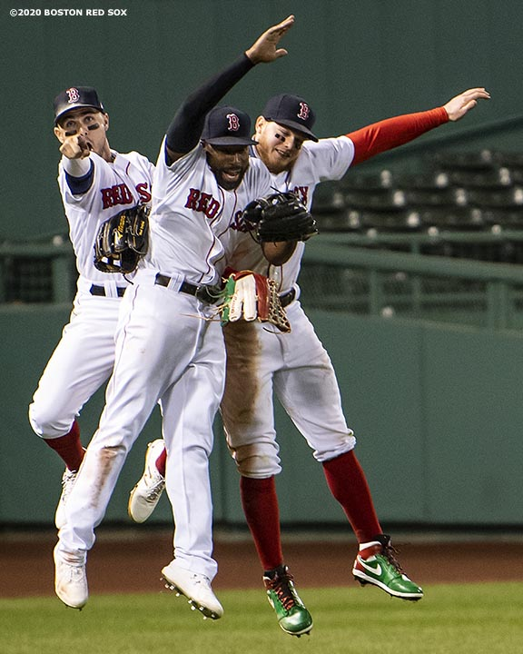 BOSTON, MA - SEPTEMBER 23: Michael Chavis #23, Jackie Bradley Jr. #19, and Alex Verdugo #99 of the Boston Red Sox celebrate a victory against the Baltimore Orioles on September 23, 2020 at Fenway Park in Boston, Massachusetts. The 2020 season had been postponed since March due to the COVID-19 pandemic. (Photo by Billie Weiss/Boston Red Sox/Getty Images) *** Local Caption *** Michael Chavis; Jackie Bradley Jr.; Alex Verdugo