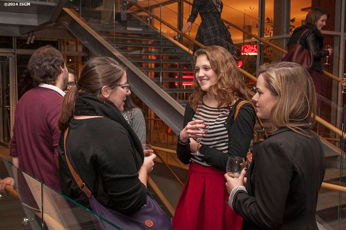 """Guests mingle in the library during a 'Winter Solstice' themed Third Thursdays at the Isabella Stewart Gardner Museum in Boston, Massachusetts Thursday, December 18, 2014."""
