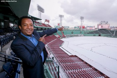 """Former Boston Red Sox pitcher Pedro Martinez poses in front of a congratulatory scoreboard message after being informed that he was inducted into the Major League Baseball Hall of Fame at Fenway Park in Boston, Massachusetts Tuesday, January 6, 2015."""