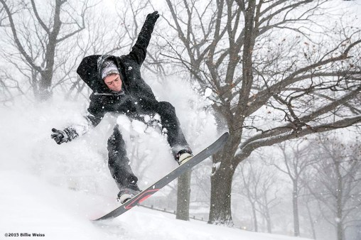 """A snowboarder goes off a jump in Amory Park during snow storm Juno in Brookline, Massachusetts Tuesday, January 27, 2015."""