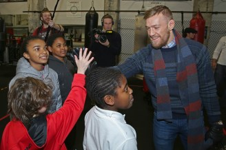 BOSTON, MA - JANUARY 09: UFC fighter Conor McGregor greets local kids during a community event at Peter Welch's Gym on January 9, 2015 in Boston, Massachusetts. (Photo by Billie Weiss/Zuffa LLC/Zuffa LLC via Getty Images)