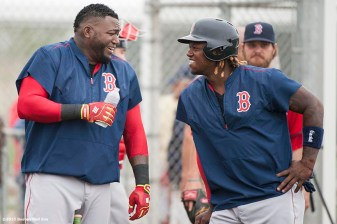 """Boston Red Sox designated hitter David Ortiz and left fielder Hanley Ramirez laugh during a team workout at JetBlue Park in Fort Myers, Florida Thursday, February 26, 2015."""