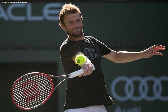 """Mardy Fish hits a forehand during a practice session at the Indian Wells Tennis Garden in Indian Wells, California Friday, March 6, 2015."""