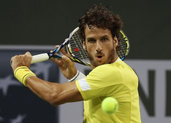 """Feliciano Lopez in action against Pablo Cuevas during their match at stadium 2 at the Indian Wells Tennis Garden in Indian Wells, California on Monday, March 16, 2015."""