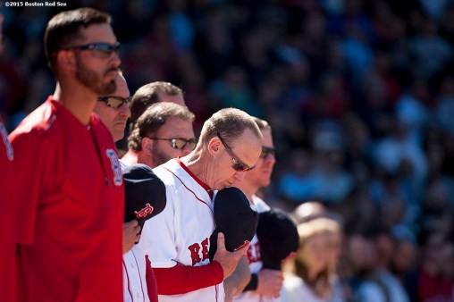 """Members of the Boston Red Sox pause for a moment of silence at 2:49 PM recognizing the anniversary of the Boston Marathon bombings during a game between the Boston Red Sox and the Washington Nationals at Fenway Park in Boston, Massachusetts Wednesday, April 15, 2015."""