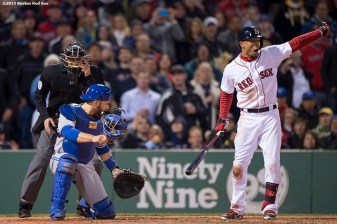 """Boston Red Sox center fielder Mookie Betts signals to a runner on base after a wild pitch during the ninth inning of a game against the Toronto Blue Jays at Fenway Park in Massachusetts Monday, April 27, 2015."""