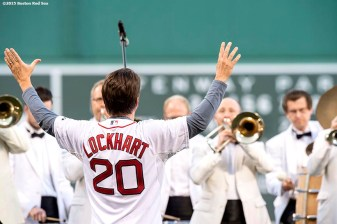 """Boston Pops conductor Keith Lockhart directs the Boston Pops in the playing of the National Anthem before a game between the Boston Red Sox and the Texas Rangers at Fenway Park in Boston, Massachusetts Thursday, May 21, 2015."""