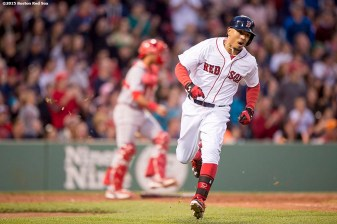 """Boston Red Sox right fielder Mookie Betts reacts after hitting an RBI pinch-hit single during the third inning of a game against the Texas Rangers at Fenway Park in Boston, Massachusetts Saturday, May 23, 2015."""