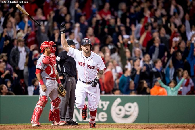 """""""Boston Red Sox first baseman Mike Napoli hits a two run home run during the sixth inning of a game against the Texas Rangers at Fenway Park in Boston, Massachusetts Saturday, May 23, 2015. It was his second home run of the game."""""""