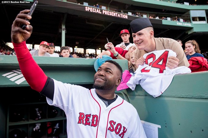 """""""Boston Red Sox designated hitter David Ortizl poses for a selfie photograph with a member of the military before a game between the Boston Red Sox and the Texas Rangers at Fenway Park in Boston, Massachusetts Saturday, May 23, 2015."""""""