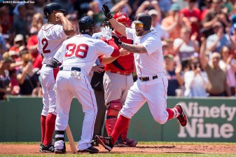 """Boston Red Sox first baseman Mike Napoli reacts after hitting a two-run home run during the second inning of a game against the Los Angeles Angels Of Anaheim at Fenway Park in Boston, Massachusetts Sunday, May 24, 2015."""