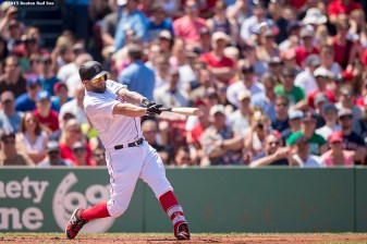"""Boston Red Sox first baseman Mike Napoli hits a two-run home run during the second inning of a game against the Los Angeles Angels Of Anaheim at Fenway Park in Boston, Massachusetts Sunday, May 24, 2015."""