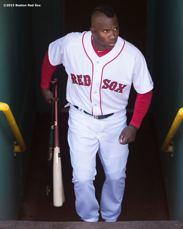 """Outfielder Rusney Castillo walks out of the dugout before a game between the Boston Red Sox and the Los Angeles Angels Of Anaheim at Fenway Park in Boston, Massachusetts Sunday, May 24, 2015."""