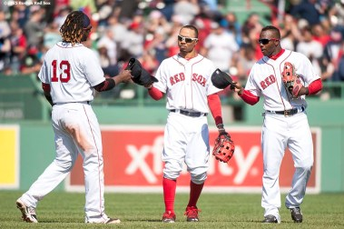"""""""Boston Red Sox left fielder Hanley Ramirez, center fielder Mookie Betts and right fielder Rusney Castillo tip their caps together after defeating the Minnesota Twins at Fenway Park in Boston, Massachusetts Wednesday, June 3, 2015."""""""