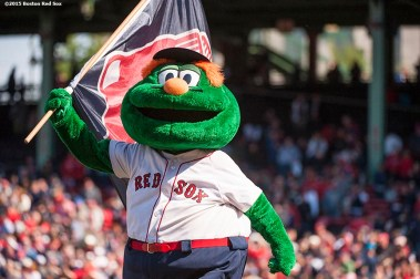 """""""Boston Red Sox mascot Wally the Green Monster runs across the field after a game against the Minnesota Twins at Fenway Park in Boston, Massachusetts Wednesday, June 3, 2015."""""""