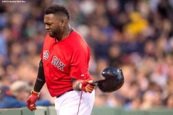 """""""Boston Red Sox designated hitter David Ortiz throws his helmet during the fourth inning of the second game of a day-night double header against the Minnesota Twins at Fenway Park in Boston, Massachusetts Wednesday, June 3, 2015."""""""