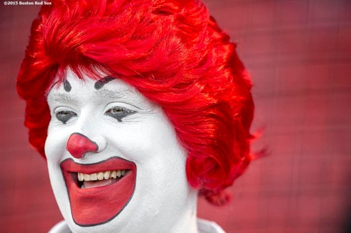 """""""Ronald McDonald smiles before a game between the Boston Red Sox and the Minnesota Twins at Fenway Park in Boston, Massachusetts Wednesday, June 3, 2015."""""""