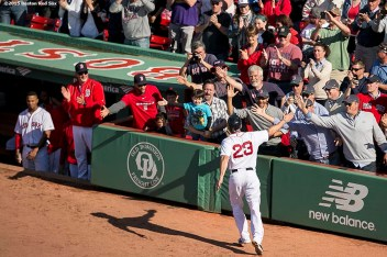 """""""Boston Red Sox catcher Blake Swihart high fives fans after hitting a solo home run during a game against the Minnesota Twins at Fenway Park in Boston, Massachusetts Thursday, June 4, 2015. It was his first career Major League home run."""""""