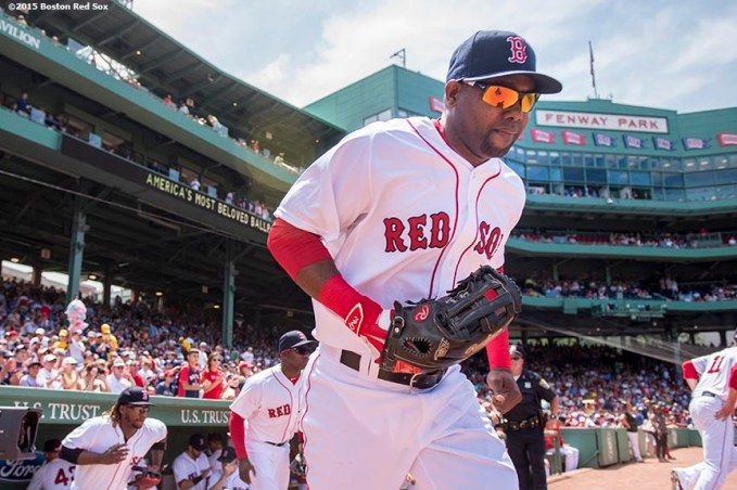 """Right fielder Alejandro De Aza runs onto the fieldbefore a game between the Boston Red Sox and the Toronto Blue Jays at Fenway Park in Boston, Massachusetts Saturday, June 13, 2015."""