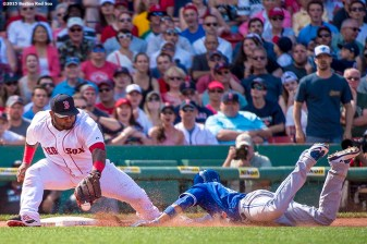 """Boston Red Sox third baseman Pablo Sandoval applies a tag during the seventh inning of a game against the Toronto Blue Jays at Fenway Park in Boston, Massachusetts Sunday, June 14, 2015."""