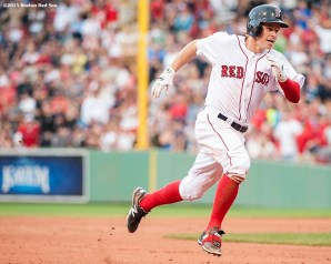 """Boston Red Sox second baseman Brock Holt legs out a triple as he hits for the cycle during the eighth inning of a game against the Atlanta Braves at Fenway Park in Boston, Massachusetts Tuesday, June 16, 2015."""