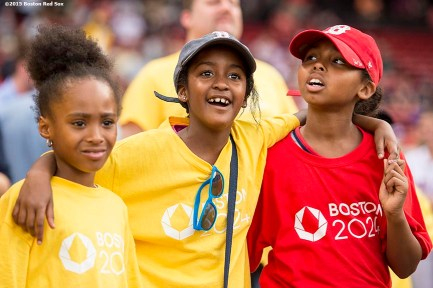 """Young fans look on during a Boston 2024 Olympic Games ceremony before a game between the Boston Red Sox and the Baltimore Orioles at Fenway Park in Boston, Massachusetts Tuesday, June 23, 2015."""