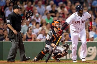 """Boston Red Sox designated hitter David Ortiz hits a two-run home run during the sixth inning of a game against the Baltimore Orioles at Fenway Park in Boston, Massachusetts Wednesday, June 24, 2015."""