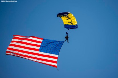 """""""A Navy Seals parachutes toward the field during a trial run before a pre-game ceremony during a CVS Hitting Clinic at Fenway Park in Boston, Massachusetts Friday, July 3, 2015."""""""