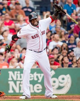 """Boston Red Sox designated hitter David Ortiz throws his bat after popping out during the first inning of a game against the Houston Astros at Fenway Park in Boston, Massachusetts Saturday, July 4, 2015."""