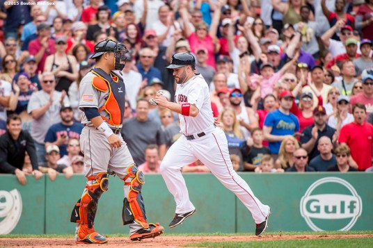 """Boston Red Sox catcher Sandy Leon scores during the sixth inning of a game against the Houston Astros at Fenway Park in Boston, Massachusetts Saturday, July 4, 2015."""