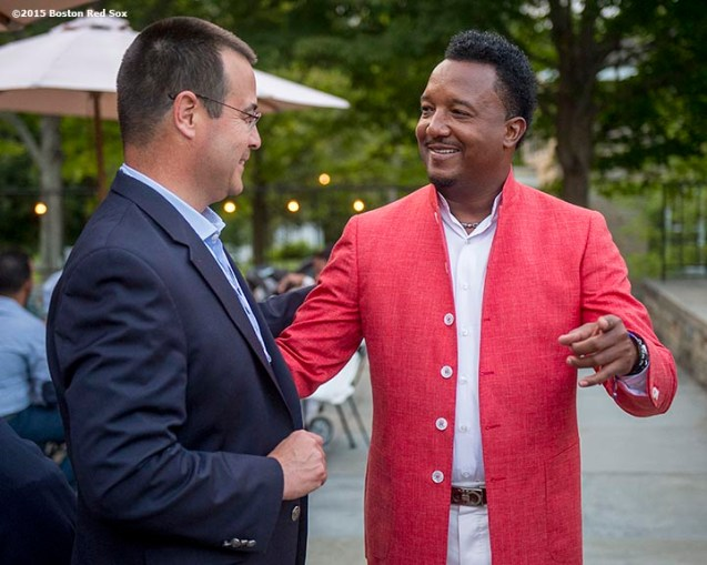 """Class of 2015 inductee Pedro Martinez talks with former Boston Red Sox General Manager Dan Duquette at a party at the Fenimore Art Museum during the 2015 Hall of Fame weekend at the National Baseball Hall of Fame in Cooperstown, New York Saturday, July 25, 2015."""
