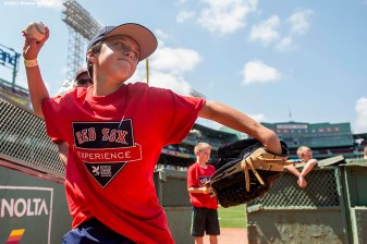 """""""A participant takes part in a pitching clinic in the bullpen during a Sox Talk clinic at Fenway Park in Boston, Massachusetts Wednesday, August 19, 2015."""""""