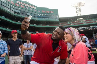 """""""Boston Red Sox designated hitter David Ortiz poses for a selfie photograph during a Jimmy Fund meet and greet at Fenway Park in Boston, Massachusetts Saturday, August 22, 2015."""""""