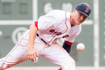 """Bosotn Red Sox second baseman Josh Rutledge reaches to field a ground ball during the ninth inning of a game against the Kansas City Royals at Fenway Park in Boston, Massachusetts Sunday, August 23, 2015."""