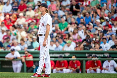"""Boston Red Sox pitcher Henry Owens reacts after giving up a home run during the second inning of a game against the New York Yankees at Fenway Park in Boston, Massachusetts Wednesday, September 2, 2015."""