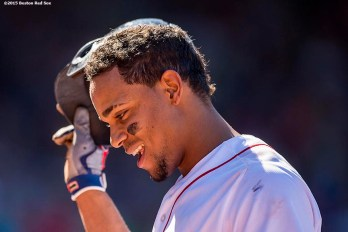 """Boston Red Sox shortstop Xander Bogaerts reacts after flying out during the fifth inning of a game against the Philadelphia Phillies at Fenway Park in Boston, Massachusetts Sunday, September 6, 2015."""