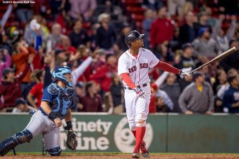 """Boston Red Sox shortstop Xander Bogaerts hits a go ahead grand slam during the eighth inning of a game against the Tampa Bay Rays at Fenway Park in Boston, Massachusetts Monday, September 21, 2015."""