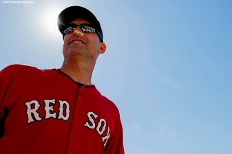 """Interim manager Torey Lovullo looks on during on-field photo day before a game between the Boston Red Sox and the Baltimore Orioles at Fenway Park in Boston, Massachusetts Sunday, September 27, 2015."""