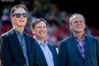 """Boston Red Sox Principal Owner John Henry, Chairman Tom Werner, and PResident & CEO Larry Lucchino look on during a tribute ceremony for Larry Lucchino before a game between the Boston Red Sox and the Baltimore Orioles at Fenway Park in Boston, Massachusetts Sunday, September 27, 2015."""