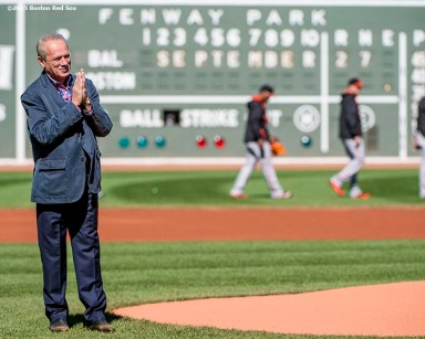 """Boston Red Sox President & CEO Larry Lucchino reacts before throwing out a ceremonial first pitch during a tribute ceremony for him before a game between the Boston Red Sox and the Baltimore Orioles at Fenway Park in Boston, Massachusetts Sunday, September 27, 2015."""