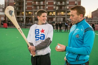"""Dublin hurler Johnny McCaffrey instructs a Boston Scholar Athlete during a hurling clinic at New Balance Field at Boston University in Boston, Massachusetts ahead of the AIG Fenway Hurling Classic and Irish Festival Tuesday, November 17, 2015."""
