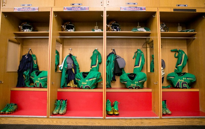 """The Notre Dame locker room is prepared during the Shamrock Series Football at Fenway game against Boston College at Fenway Park in Boston, Massachusetts Saturday, November 21, 2015."""